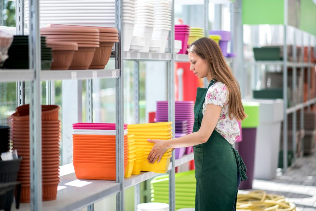 retail employee efficiently stacking containers