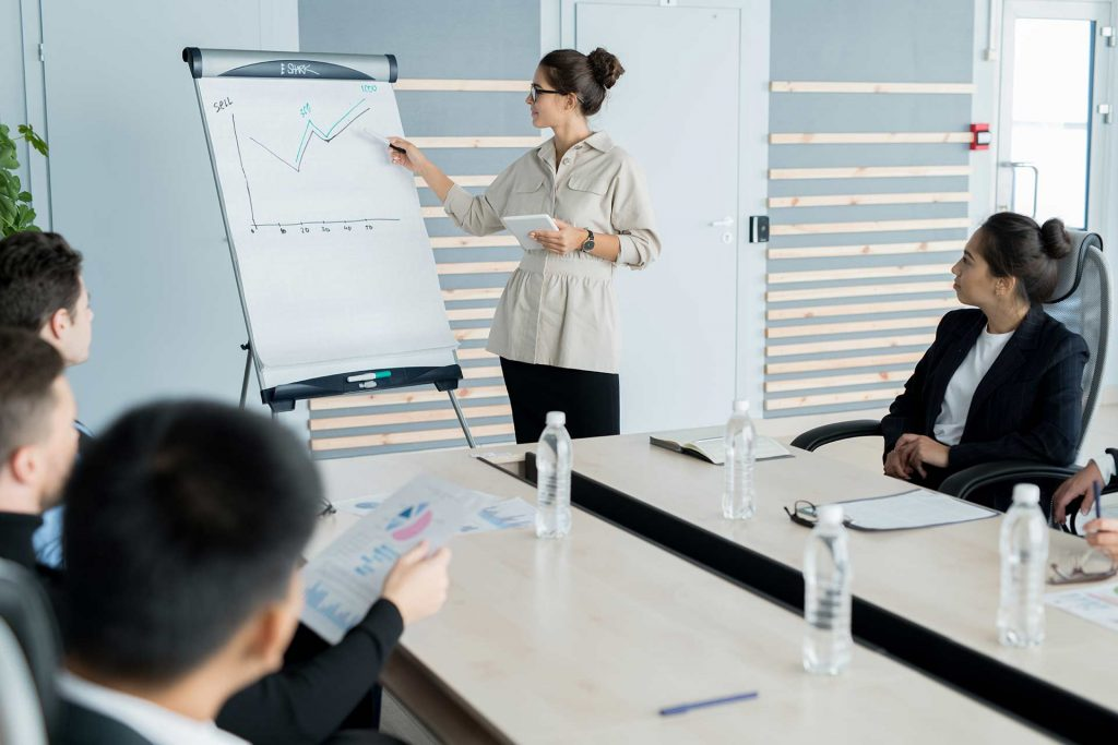 Retail professional trying to forecast new product on white board