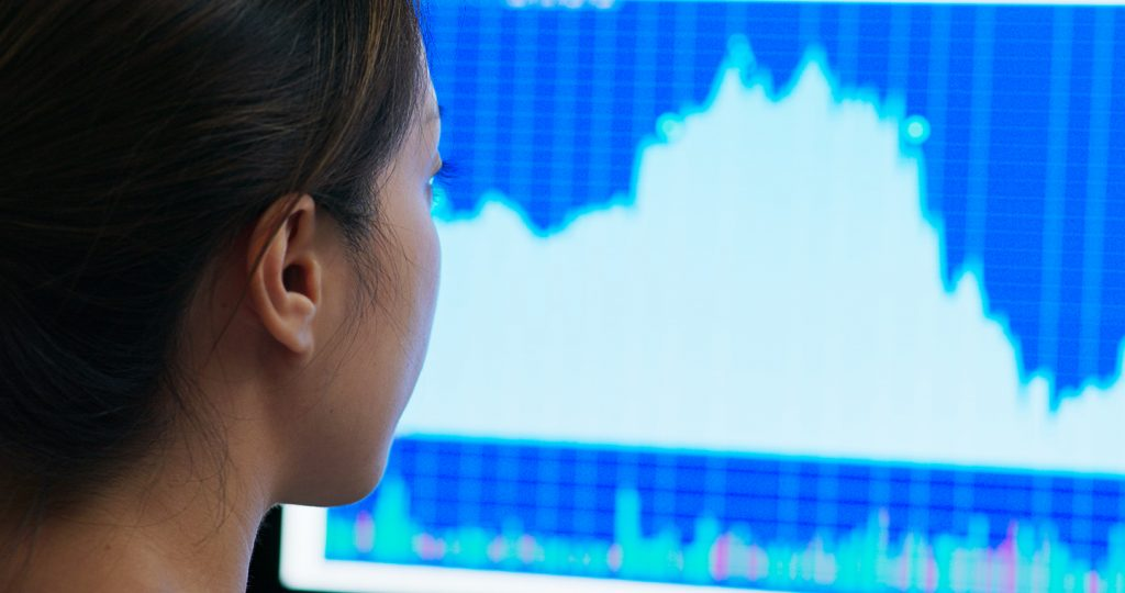 Retail planner looking at a demand forecast on a computer screen