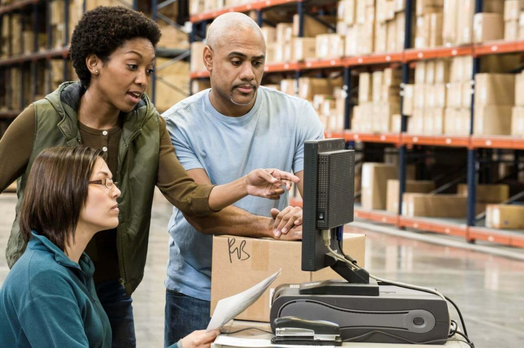 To drive meaningful results, retailers must use the right tools for product clustering. (Pictured are three retailers looking at a computer)