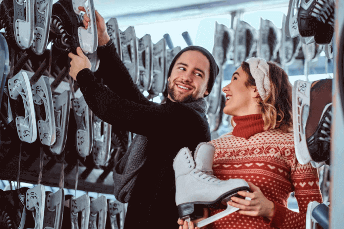 A man and woman shopping for ice skates - a product that would require accurate seasonal demand forecasting.